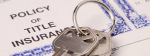 Set of house keys laying on top of Policy of Title Insurance